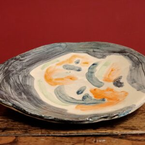 Glazed earthenware dish.