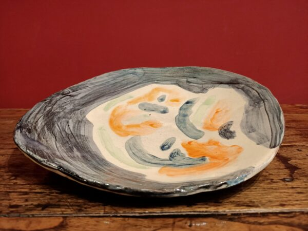 Glazed earthenware platter.