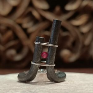 Wrought iron silver and pink stone ring.