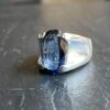 Picture showing a silver ringwith blue stone
