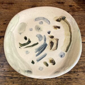 Picture showing a small glazed earthenware plate