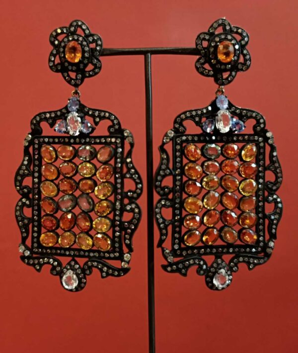 Yellow sapphires, white topaz and tanzanite earrings.