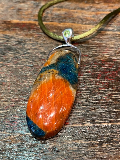 Orange calcite pendant with silver bail and peridot.