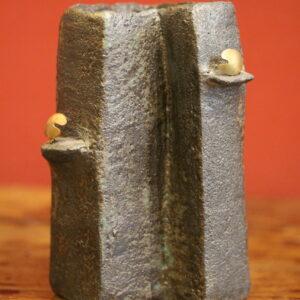 Enamelled black stoneware vase.