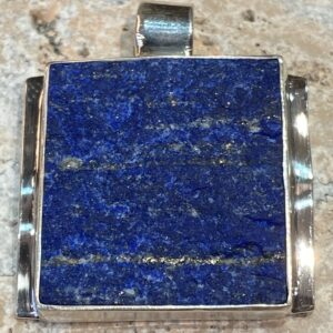 Sterling silver pendant with lapis lazuli.