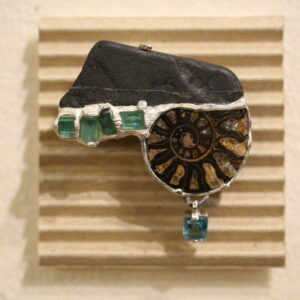 Black stone, amonite, tourmaline, apatite and silver brooch by Hélène Thomas.