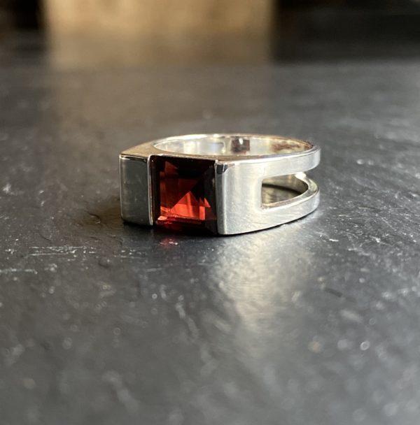 Very bright garnet set on a sterling silver ring.
