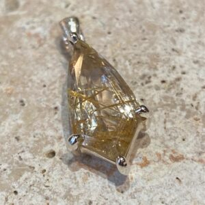 Sterling silver pendant with rutilated quartz.
