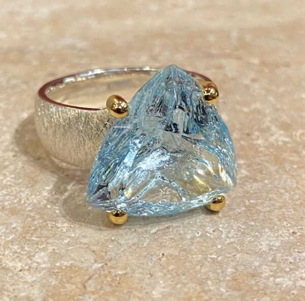 Brushed silver, vermeil and topaz ring.